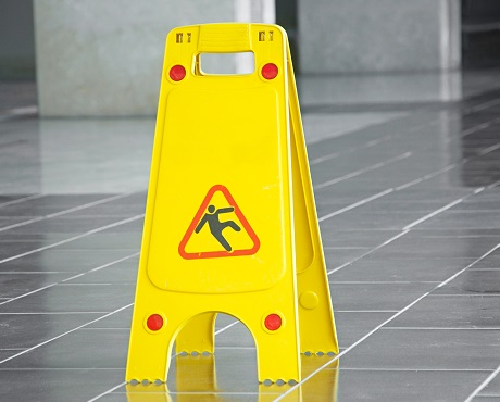 Wet floor sign suggesting Liability insurance