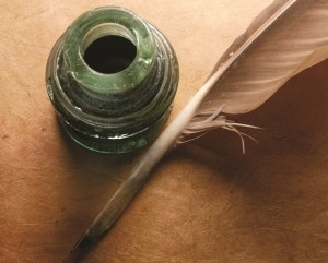 Ink pot and a feather quill pen