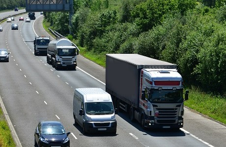 Various vehicles driving along a motorway with motor insurance