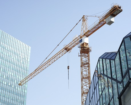 crane against glass city skyline, trade associations | Kerry London Construction insurance