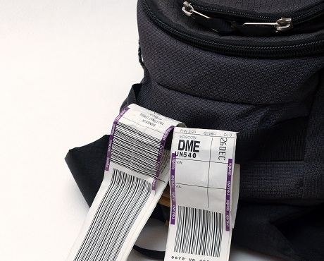 Travel luggage labels representing Travel insurance