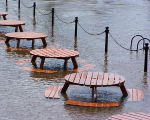 Row of partially submerged picnic benches representing Business Interruption insurance