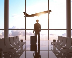 Business travel with man looking through window representing business travel insurance