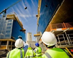 builders watching a crane in a city scene