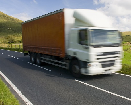 White commercial vehicle driving through countryside REPRESENTING Commercial vehicle insurance