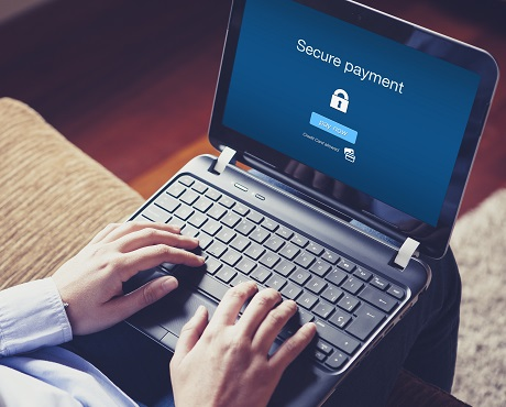 Laptop being used to log in to a secure website representing Cyber insurance