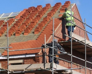 roof contractors working on a tiled roof