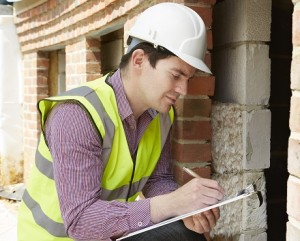 Tradesman making notes about a building