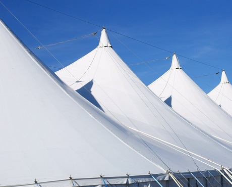 4 marquees in a line representing event cancellation insurance