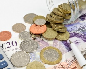 UK coins and bank notes representing Money insurance