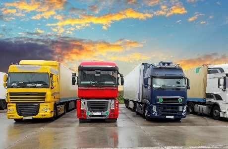 Fleet of large commercial lorries representing Fleet insurance