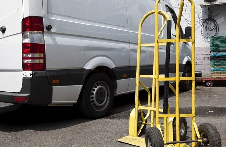 sack trolley in front of white van representing Goods in transit insurance