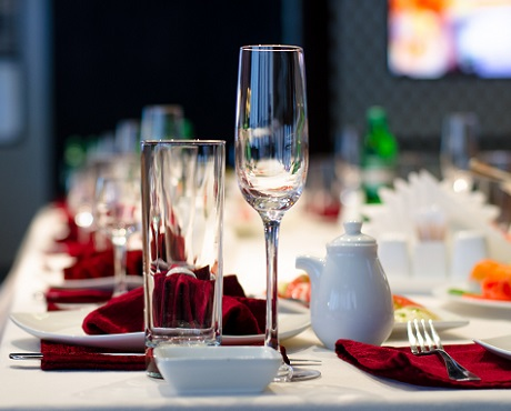Set table with glasses, linen and cutlery, representing Hospitality insurance