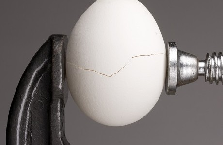 An egg being cracked, representing the value of brand reputation insurance