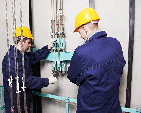 Engineers inspecting a lift representing Engineering insurance