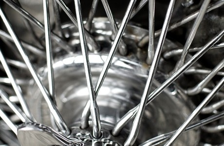 Highly polished chrome car wheel with Personal motor insurance