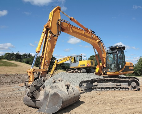 2 commercial earth moving machines representing plant insurance