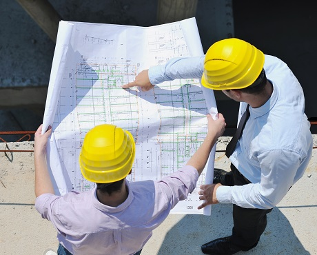 Two construction workers looking at project insurance | Kerry London Limited