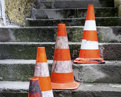 Traffic cones on steps representing public liability insurance