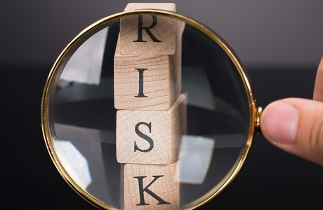Wooden blocks spelling RISK, Specialised risks | Kerry London Limited