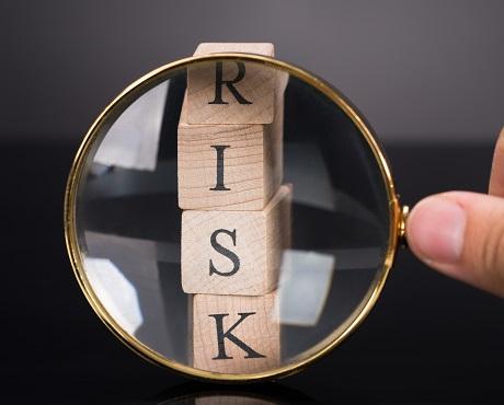 Wooden blocks spelling RISK, Specialised risks | Kerry London Limited